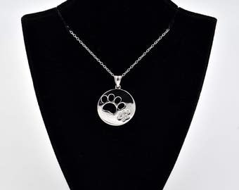 Sterling Silver Rhodium Plated Cut Out And CZ Paw Paws Necklace