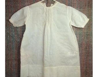 Vintage baby gown with pretty hand worked embroidered and pleated front, puffy short sleeves. Has been darned. No tag. See description below