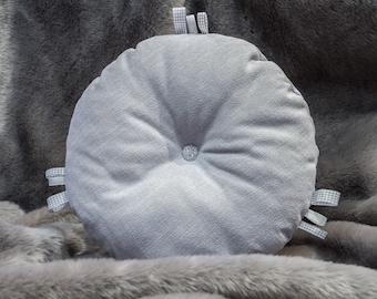 Light pastel grey/blue decorative round pillow