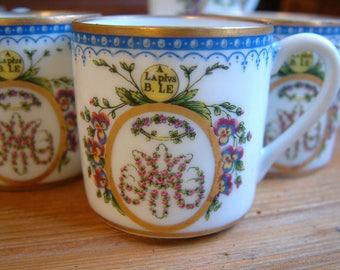 Set of 5 french vintage porcelain espresso coffee cups. Vintage espresso coffee cups with saucers. Demi-tasse cups. Flowers and gold trim.