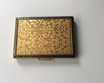 Vintage compact.  Rex 5th Ave.  Beautiful and elegant gold embossed compact.  Still has makeup. Art Deco, from the 40's.