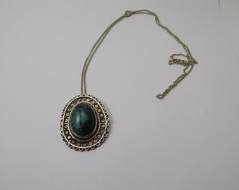 Beautiful turquoise hand made sterling silver pendant with 24 inch silver necklace