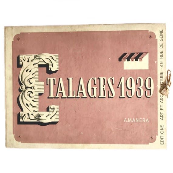Etalages 1939. Scarce book of loose prints of fashion and beauty window displays.