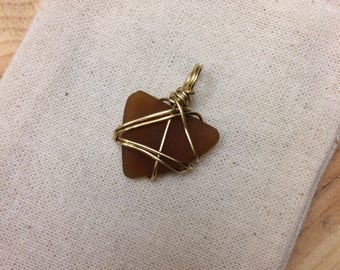 Wire wrapped brown sea glass