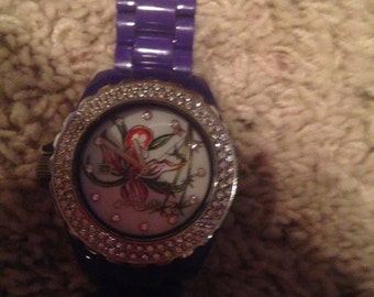 Unique orchid watch with plastic purple band