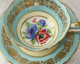 Paragon, England: tea cup and saucer, white, blue, red and gold, with poppies