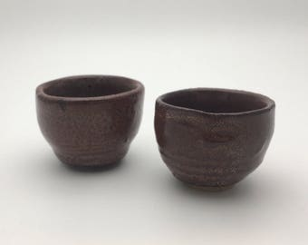 Handmade set of two brown and white patterned sake cups, wheel thrown, stoneware, glazed
