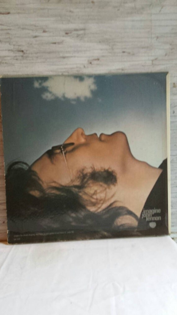 Vintage 1971 John Lennon Album Imagine with Yoko and the Plastic Ono Band. Produced by John and Yoko and Phil Spector.  Vinyl looks VG.