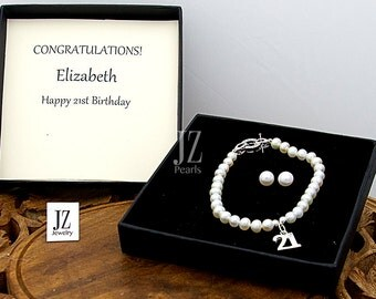 Freshwater Pearl Bracelet with a Sterling Silver 21st Charm and fastened with a Beautiful Crystal Studded Sterling Silver Clasp.