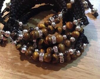 Bracelet of amethyst / eye of Tiger (stones semiprecious) e thread of macrame black