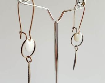 White pair of earrings