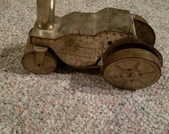 "Wind up steam roller toy. ""Wind up don't work but could be fix"""