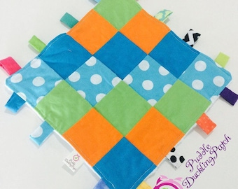 Baby sensory Tag blanket: Baby boy orang and dots cotton and Minky blanket.