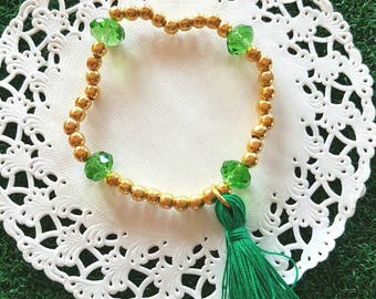 Oriental-inspired bracelet with stones gold beads and tassels