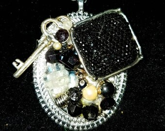 OOAK One of a kind assemblage collage necklace using black rhinestone, silver and pearl vintage jewelry!