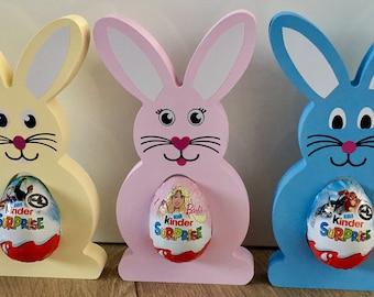 Easter bunnies holds a kinder egg