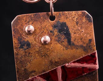 Black patina and red patina, cold connection pendant, and earrings, one of a kind