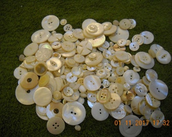 Assorted perlized buttons.