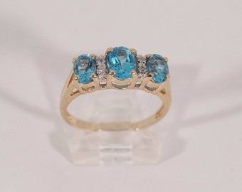 14K Yellow Gold Blue Topaz and Diamond Ring , 3.7 grams, size 8