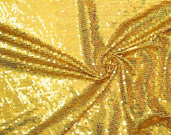 Fabric solid sequin stretch GOLD 58 inches wide. Sold by the  1/2 Yard