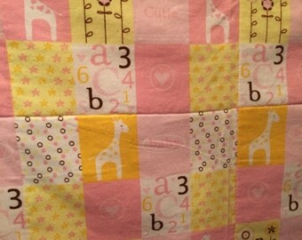 Pink Giraffes, letters, and numbers.  A soft baby/toddler quilt just for girls