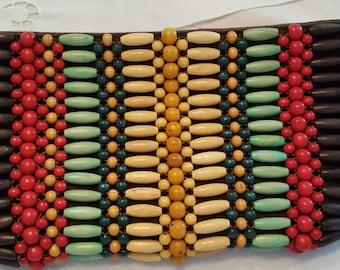 Handbag clutch with wooden beads
