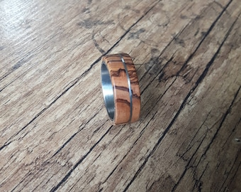 Titanium ring with olive wood and a titanium band