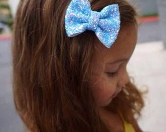 Chunky glitter baby blue bow on an alligator clip or skinny elastic headband