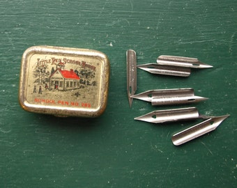 Seven Fountain Pen Nibs of Various Sizes – Comes in a miniature Tin Box 'Little Red School House – School Pen No. 283'