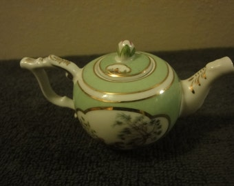 two miniature TEA POTS approx length around 8cm and 10cm