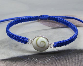 Eye of Saint Lucia and feminine silver Midnight Blue cord bracelet