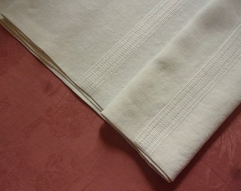 A former white fine linen, office, harvest, old linen tablecloth