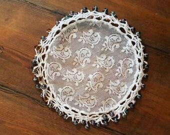 Vintage beaded circle doily