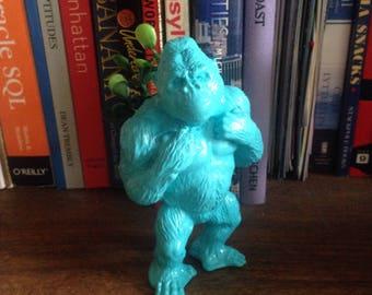Oscar, the blue gorilla planter, with realistic plant