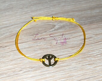 Elegant bracelet yellow with peace pendant