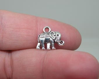 12 Silver Tone Indian Elephant Charms. B-009