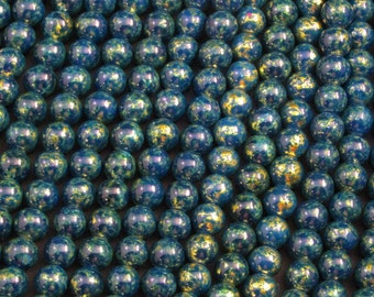 "8mm Dark Blue and gold ceramic beads that often appear green- 16"" / 8"" / 4"" strands - generous quantity discounts start @ 10 dollars!!!"
