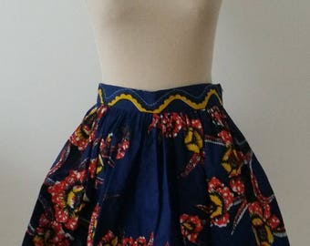 Skirt manalecreation in African wax print blue, red and yellow floral pattern