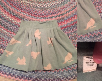 Mini skirt with bird detailing