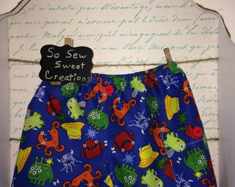 Little Monsters Cargo Shorts with side pocket for little boys. Size 18-24M+. Primary colors and 2 red buttons. Lots of detail!!!