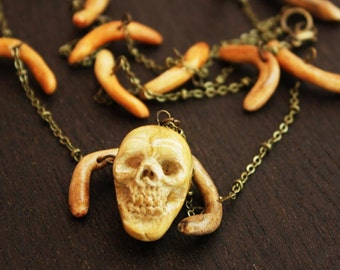 IVORY SKULL NECKLACE with bones pagan tribal pendant