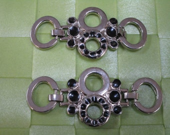 "2 pieces in 2 3/4"" length x 1"" width with silver tone with black color applique for your sewing  and wedding project."