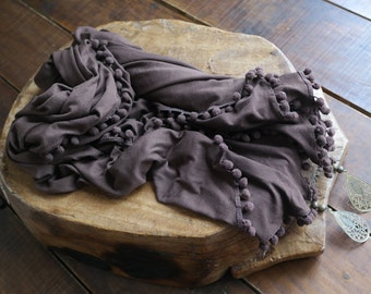 Uniquely colored purple/grey scarf with pom poms and medallions