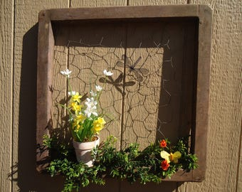 Wood frame with chicken wire wall hanging