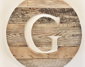 Monogrammed cut out reclaimed wood sign