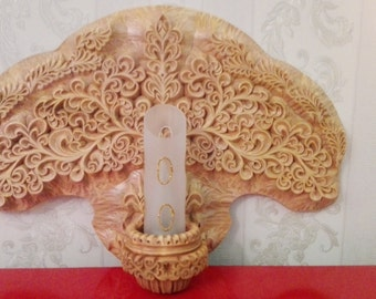 Wood carving. Decoration for the bedroom or living room.