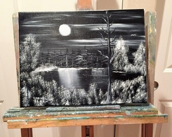 Oil painting in black and white of full moon over lake