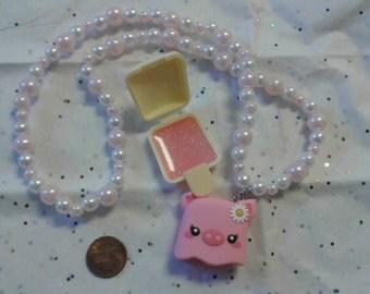 Pink piggy lip gloss necklace