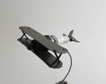 Reclaimed spark plug plane (fine detailed metal art)