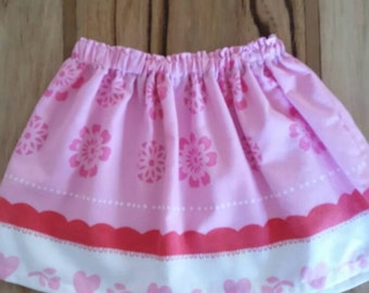 Little girls pink heart and flower patterned skirt made from recycled fabrics. Size1